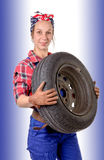 Woman wearing a mechanic car wheel Stock Photography