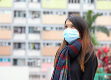 Woman wearing medical face mask Stock Images