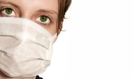 Woman wearing medical mask. Woman with green eyes wearing medical mask Royalty Free Stock Image