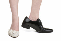 Woman wearing men's shoes of lesbian marriage Stock Image