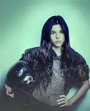 Woman wearing mesh sports top holding helmet Stock Photos