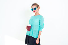 Woman wearing mint blue sunglasses and top with messy hairstyle, smiling. Portrait of fit blond glamorous female model Royalty Free Stock Photos