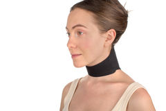 Woman wearing neck brace, bandage. Close-up woman with bandage, brace on her neckwearing medical sport  band isolated on white background Stock Photos