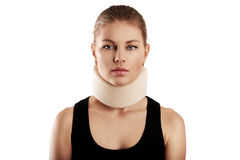 Woman wearing neck collar. Portrait of young woman wearing neck collar. Concept of cervical sprain and therapy stock photography