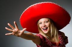 Woman wearing nice. Red sombrero stock image
