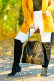 Woman wearing orange autumn cardigan outdoor stock images