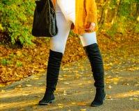 Woman wearing orange autumn cardigan outdoor royalty free stock images