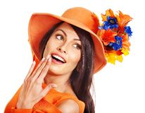 Woman wearing orange hat with flower. Royalty Free Stock Images