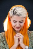 Woman Wearing Orange Hijab Headdress stock photo