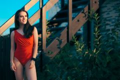 Woman Wearing an Orange One Piece Swimsuit in Summer Holiday Stock Photography