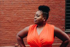 Woman Wearing Orange Sleeveless Top Royalty Free Stock Photography