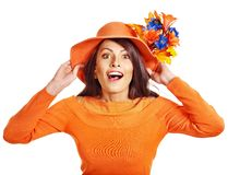 Woman wearing orange sweater and hat. Royalty Free Stock Photo