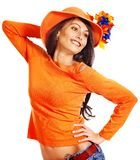 Woman wearing orange sweater and hat. Stock Photography