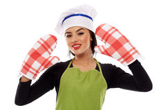 Woman wearing oven gloves Stock Images