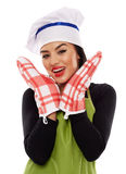 Woman wearing oven gloves Royalty Free Stock Photography