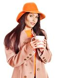 Woman wearing overcoat and hat. Royalty Free Stock Photos