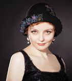 Woman wearing painted felt hat in retro stlyle Stock Photography