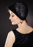 Woman wearing painted felt hat in retro stlyle Stock Images