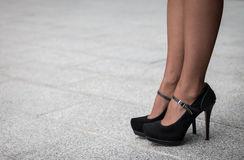 Woman wearing a pair of black classic high heels Royalty Free Stock Photo