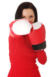 Woman wearing a pair of boxing gloves Stock Photography