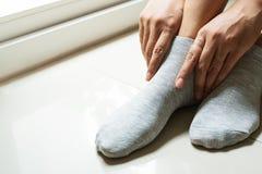 Woman wearing a pair soft grey sock stock photos