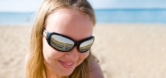 Woman wearing a pair of sunglas Royalty Free Stock Photo