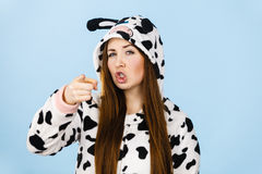 Woman wearing pajamas cartoon angry expression. Teen girl in funny nightclothes, pajamas cartoon style showing angry face expression pointing, wagging finger Royalty Free Stock Photo
