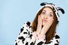 Woman wearing pajamas cartoon making silly face. Happy teenage girl in funny nightclothes, pajamas cartoon style making silly face, positive face expression Stock Image