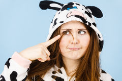 Woman wearing pajamas cartoon making silly face. Happy teenage girl in funny nightclothes, pajamas cartoon style making silly face, positive face expression Royalty Free Stock Photo