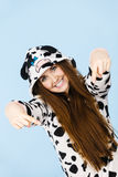 Woman wearing pajamas cartoon pointing down. Happy teenage girl in funny nightclothes, pajamas cartoon style pointing down at copy space with positive face Stock Image