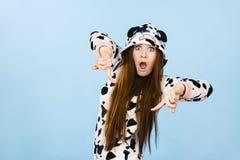 Woman wearing pajamas cartoon pointing down Royalty Free Stock Photos