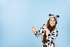 Woman wearing pajamas cartoon pointing up Stock Image