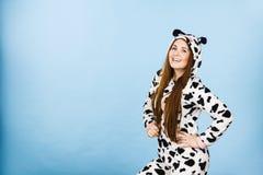 Woman wearing pajamas cartoon smiling. Happy teenage girl in funny nightclothes, pajamas cartoon style smiling, positive face expression, studio shot on blue Stock Photo