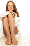 Woman wearing pantyhose. Portrait of smiling young woman wearing pantyhose stock photography