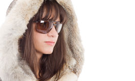 Woman wearing parka. Portrait of relaxed fashionable woman wearing parka overcoat with bare chest, isolated on white background Stock Image