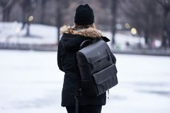 Woman Wearing Parka and Carrying Backpack during Winter Stock Images
