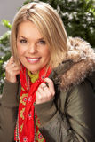 Woman Wearing Parka Coat And Scarf In Studio Stock Photography