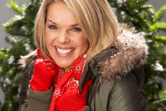 Woman Wearing Parka Coat And Scarf In Studio Royalty Free Stock Photo