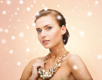 Woman wearing pearl statement necklace Stock Photo
