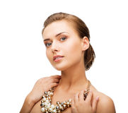 Woman wearing pearl statement necklace Royalty Free Stock Photos