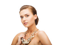 Woman wearing pearl statement necklace Stock Photography