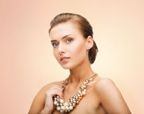 Woman wearing pearl statement necklace Stock Images
