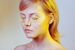 Woman wearing petal eyelashes Stock Photos