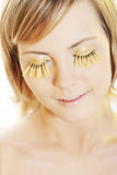Woman wearing petal eyelashes Royalty Free Stock Images