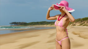 Woman wearing pink bikini. Stock Images