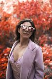 Woman Wearing Pink Blazer and Cat-eye Sunglasses royalty free stock images