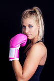 Woman wearing pink boxing gloves Stock Photography