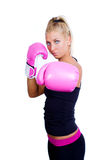 Woman wearing pink boxing gloves Royalty Free Stock Photo
