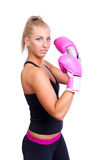 Woman wearing pink boxing gloves Stock Images