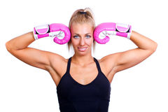 Woman wearing pink boxing gloves Royalty Free Stock Photos